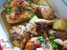 Chicago Style Chicken Vesuvio - Proud Italian Cook. Chicken pieces and potatoes are browned on the stovetop, then baked off in the oven with wine, garlic and herbs. Green peas are added near the end of baking. Magnifico!