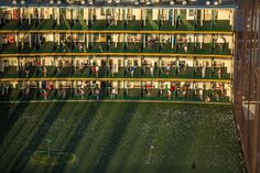 Driving range at Chelsea Piers, Manhattan.  Summer Over the City | The New Yorker