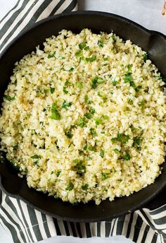 Low carb & paleo friendly Cilantro Lime Cauliflower Rice - make it in 20 minutes or less for a healthy & filling side dish! Gluten Free   Whole30   Vegan