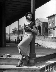 Starlet Debra Paget, eating an apple in the shade. (Photo by Peter Stackpole//Time Life Pictures/Getty Images)