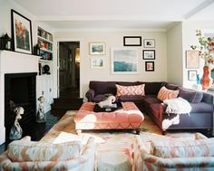 chambre violet orange | Bohemian Living Room - A purple sectional couch and a pink tufted ...