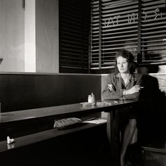 """April 1943. Washington, D.C. """"Girl sitting alone in the Sea Grill waiting for a pickup. 'I come in here pretty often, sometimes alone, mostly with another girl, we drink beer, and talk, and of course we keep our eyes open-you'd be surprised at how often nice lonesome soldiers ask Sue, the waitress, to introduce them to us.' """""""