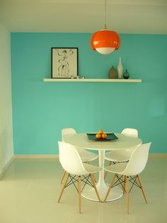 Little dining table.what a wall color! Love it.