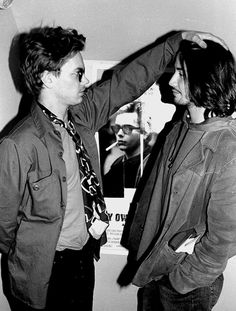 River Phoenix and Keanu Reeves clown around at the cast party in 1991.