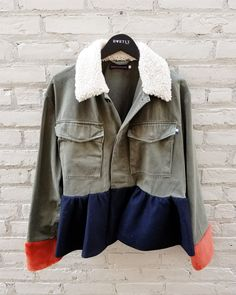 Get to know the designer Harvey Faircloth this season. With vibrant pops of colors displaced on bombers, military jackets and other outerwear, it's easy to see why these pieces are being spotted all throughout New York Fashion Week!  Call to order this two-toned shearling military jacket from #Hartly today: 201.664.3111 or email Sales@hartlyfashions.com.