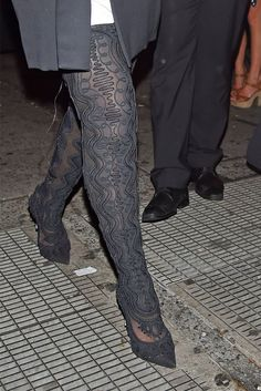 Rihanna in Sergio Rossi thigh-high boots in New York City.