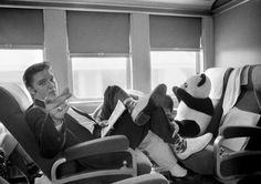 GOING HOME TO MEMPHIS: Elvis traveling by train to Memphis, TN from New York on July 4, 1956; by Alfred Wertheimer