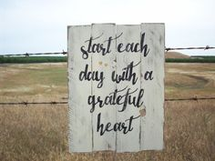 Rustic wood sign with a great inspirational message to start each day with a grateful heart. Sign has been painted with a background of
