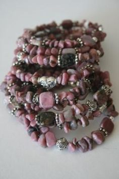 Memory wire bracelet using pink stones and silver beads.