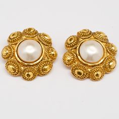 Chanel Vintage Gold Gilt Flower with Faux Pearl Earrings Signed Chanel. These earrings feature clip backings. #mdvii #catalog #earrings #pearl #vintage