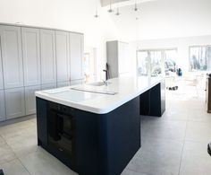 Mixed cabinetry with handless shaker and flush, navy handless island. XL grey concrete effect floor tiles. Bi-fold doors out to deck. White Shaker Kitchen, Grey Kitchen Island, Navy Kitchen, Kitchen Doors, Kitchen Flooring, Black Kitchens, Cool Kitchens, Modern Kitchens, Kitchen Installation