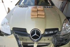 Discovery: The dog alerted the officials to a hidden compartment inside Pikula's car, where they reportedly found six packages of cocaine, worth nearly $134,000. Above, the packages are pictured on Pikula's vehicle