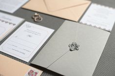 Custom Wedding Invitation Suite with grey pocket folder, silver wax seal, and blush-peach details | Styled Photo Shoot | Art by Ellie | Custom Wedding Invitations | Modern Calligraphy | Envelope Printing | Serving Clients Nationwide