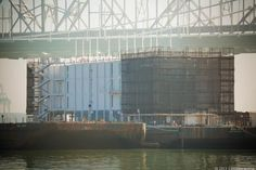 Is Google building a hulking floating data center in SF Bay?  It looks like Google has been working on an oversize secret project on San Francisco's Treasure Island. A water-based data center? Could well be. http://news.cnet.com/8301-1023_3-57608585-93/is-google-building-a-hulking-floating-data-center-in-sf-bay/