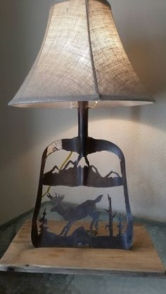 Hand made lamp from an old shovel features a by ValhallaIronWorks Welding Art Projects, Metal Art Projects, Metal Art Decor, Scrap Metal Art, Paper Artwork, Metal Artwork, Shovel Decor, Railroad Spikes Crafts, Plasma Cutter Art