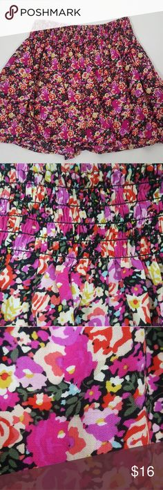 """Express Size XS Stretchy Floral Print Skirt Women's Size XS Express Stretchy Floral Print Skirt. The skirt is in excellent preowned condition. No rips or stains. Material is 100% rayon. Machine Washable. Has stretchy elastic waistband for comfort. Skirt will make a cute easy outfit. Skirt is 15"""" in length. Thank you for looking! God bless. Express Skirts"""