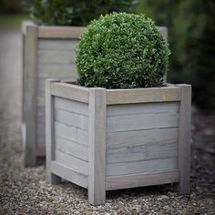 Stylish wooden planter.Perfect for filling with plants and placing outside in front of a French window, by a door or on a patio. These hardwaring planters, add elegance and charm to a country garden or equally on a city apartment balcony. Available in 2 sizes 40cm square or 60cm square and handcrafted from contemporary slatted panels of Spruce, taken from fully sustainable and responsible sources within the EU.Crafted from Spruce wood.Medium H40 x W40 x D40cm Large H60 x W60 x D60cm