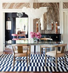 Gabriel Hendifar dining room agate walls black white striped rug bulb pendant