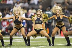 Post: A cheerleader for the New Orleans Saints (some of the team's cheerleaders are pictured in a file photo) says she was fired after sharing a photo that was deemed inappropriate