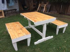 Recycled pallet table and bench seats. The tops have been raw linseed oiled. and the base has exterior paint on them. Very soild. 1.4 mtrs long and 700mm high. The seats are 400 mm x 400mm x 1.4