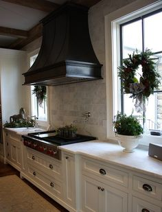 Kitchen Hood Design Dilemma, Adore Your Place - Interior Design Blog...Love the black hood over the range