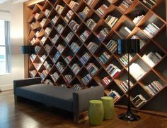 For the life of me I cannot find the original website of this photo. Is it a custom made diagonal bookshelf? Does anyone know? I see this in our remodeled basement. - Daydreamin' Rachel