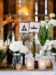Love this idea for how to name your event tables and love the moss wrapping!
