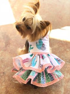Adorable Halter design Dog Dress. Velcro closure around neck and chest make for easy on and off and comfort. XXS Measurements: 8-9 chest • 7-8 neck • 8 in length XS Measurements: 10-11 chest • 8-9 neck • 10 in length S Measurements: 12-15 Chest • 9-10 Neck • 14 Length Size Medium