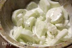 Classic Sour Cream Cucumber and Onion Salad - A cucumber and sweet Vidalia onion salad, dressed with a vinegar and sour cream dill dressing. Definitely a Southern favorite!