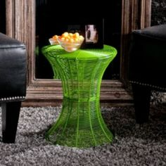 The bright modern design makes this green wire round side accent table a fabulous piece for any home. Designed with many layers of wire, this table is both functional and stylish and can be used as a side table beside your sofa or patio.