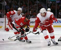CHICAGO IL - MAY 29: Damien Brunner flips puck past Dave Bolland - Game Seven