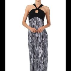 ⬇️FINAL MARKDOWN⬇️Zebra Print Halter Dress Super cute maxi dress with halter straps that cross in the back. You can dress this down with simple sandals or dress it up with strappy heels. MADE IN THE U.S.A. 95% polyester/5% spandex. Never worn. Canari Dresses