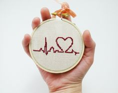 Hand embroidery - Burgundy heart with palpitation - Cute cross stitch in wooden hoop. $17.50, via Etsy.