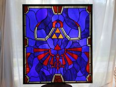Video Game inspired stained glass? Yes, please! Here is an example of one inspired by The Legend of Zelda series. The artist can be found on...