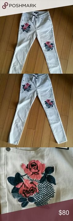 Embroidered skinny jeans Beautiful skinny jeans with two sections of pink rose embroidery. The size says small. These measure 13 1/2 the waist flat. Would fit a size 26/27. Romeo & Juliet Couture Jeans Skinny