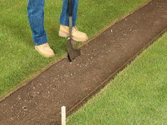 Lay out pegs and string lines along the edges of the path. Dig out the path area to a depth of paver height plus a 2-inch (5-cm) sand bed.