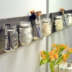 Bathroom organizer - need wood, mason jars, hose clamps, picture hangers, screws and a drill Mason Jars, Diy Playbook, Bathroom Organisation, Bathroom Storage, Fun Crafts For Kids, Bathroom Inspiration, Sweet Home, House Design, House Styles