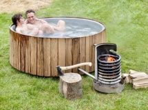 Wood fired The Dutchtub Wood is a wood fired outdoor hot tub: a fire in the coil warms the water in the tub. Natural circulation causes the colder water at the bottom of the Dutchtub to go in...