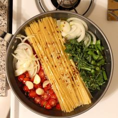 INGREDIENTS 12 ounces linguine/spaghetti 12 ounces cherry or grape tomatoes, halved or quartered if large 1 onion, thinly sliced (about 2 cups) 4 cloves garlic, thinly sliced 1/2 teaspoon red-pepper flakes 2 sprigs basil, plus torn leaves for garnish 2 Tbsp EV Olive Oil, plus more for serving Salt and ground pepper to taste 4 1/2 cups water Freshly grated Parmesan cheese, for serving 9 minutes