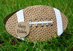 """By Cheryl Gaffney. Football Shaped Card. Cut shaped card base from kraft cardstock. Dry emboss in """"Bubbles"""" folder. Ink with brown ink. Set eyelets with Crop a Dile, add white stripes, and lace it up. Add sentiment."""