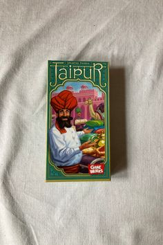 Jaipur was introduced to me by a friend of mine and it instantly blew my mind. So much so that I kept his copy for years before finally having to give it back and purchase my own copy.  It is so simple to teach. The box might say ages 12+ but in my opinion it is just fine for 8 years and up. The boardgamegeek community also agrees with me on this one.  I taught it to my nephew and we were playing within 5 minutes. #boardgames #Jaipur Great Hobbies, 8 Year Olds, Colour Schemes, Jaipur, Board Games, Boards, Community, Baseball Cards, Play