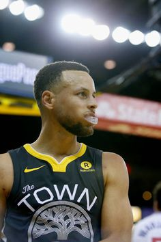 Stephen Curry of the Golden State Warriors looks on during the game against the Los Angeles Clippers at ORACLE Arena on February 22 2018 in Oakland...