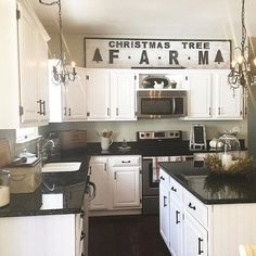 Love this white kitchen and the DIY Christmas Tree Farm sign