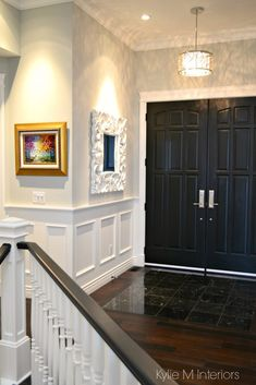 How to choose paint sheen, finish. Foyer, front door painted black, gray walls, white wainscoting