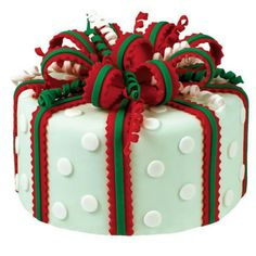 Holiday Happiness Cake - Holiday wrapping starts now! Add a festive touch to this cake with seasonal colors, fun cut outs, cute curlicues, and a magnificent ribbon striped bow. Watch our online video. Christmas Cake Designs, Christmas Cake Decorations, Christmas Cupcakes, Christmas Sweets, Holiday Cakes, Christmas Baking, Xmas Cakes, Simple Christmas, Christmas Holidays
