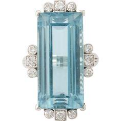 Vintage platinum Aquamarine  diamond ring.   Circa:late 1940's early 1950's.    Exquisite platinum  ring is approx. 18 carat rectangular step cut