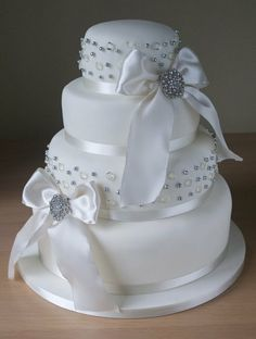 4 tier wedding cake with ivory satin bows, sparkly brooches and edible diamonds delivered to Chequers hotel today. Diamond Wedding Cakes, 4 Tier Wedding Cake, Round Wedding Cakes, White Wedding Cakes, Elegant Wedding Cakes, Beautiful Wedding Cakes, Beautiful Cakes, Amazing Cakes, Diamond Cake