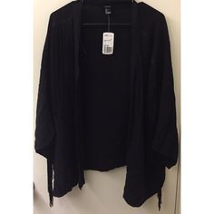 NWT Forever 21 Black Fringe Cardigan NWT Forever 21 black fringe cardigan. Perfect for festival season. The fringe starts at the shoulder & goes down the arm. Price is negotiable. Feel free to make an offer. 🚫 No Trades 🚫 No PayPal 🚫 No Lowballing Forever 21 Tops
