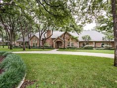 This beautiful, completely updated one-story home on 1.67 private, heavily wooded acres in exemplary Carroll ISD offers a superb floor plan. The three living areas at 1223 Morgan Road in Southlake include a sunroom – bringing the outdoors in all year round.