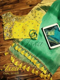 Sea green and yellow organza saree with beautiful pearl and zardosi detailing. Don t miss the super cute tassels! To order please WhatsApp on 9949944178 or mail us Sari Blouse Designs, Saree Blouse Patterns, Fancy Blouse Designs, Saree Tassels, Stylish Blouse Design, Green Saree, Yellow Saree, Organza Saree, Elegant Saree
